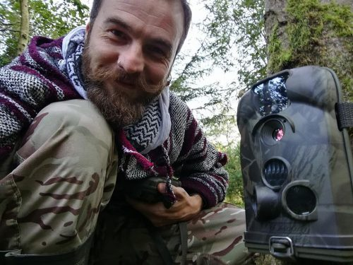 Cameraman/editor Craig Morris setting up camera traps on location