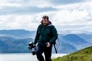 Camera/editor Craig Morris filming on location, Great Orm